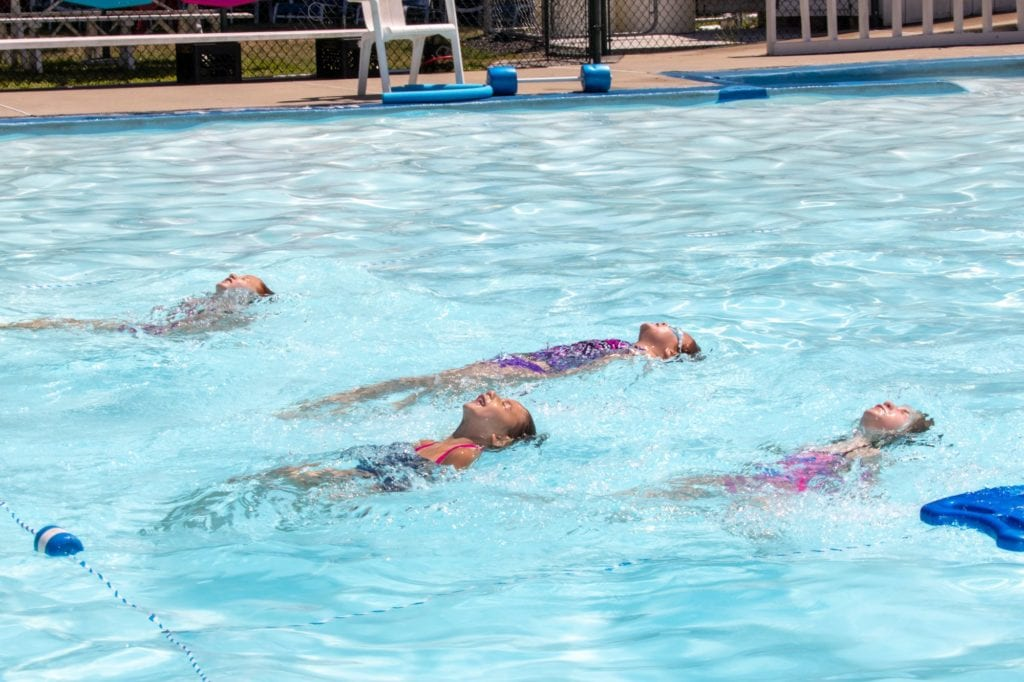 girls swimming on back